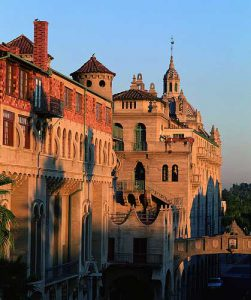 "Built between 1902 and 1932, and now considered to be Riverside's ""symbol,"" the Mission Inn is a masterpiece mixture of Mission and Spanish Revival, Moorish, and Asian architectural styles."