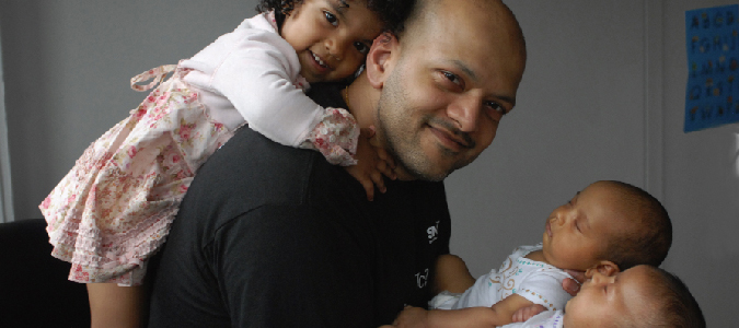 Akash Sharma, M.D., with his daughters