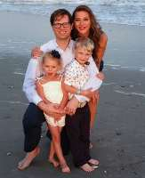 Joseph Cheatle, M.D., poses with his family at beach.