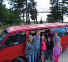 """To help their family of eight get around during their year in New Zealand, the Caldwells bought a van (which they nicknamed """"Big Red"""") at the start of their trip."""
