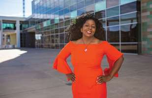 Candace Bellamy, M.D., pursues both her passions: practicing medicine and singing professionally. - Photo by John David Weddings.