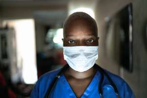 Portrait of female nurse / doctor with face mask