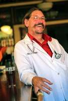 """For Mark Zilkoski, M.D., owner of the Doc'Z pub in Wolf Point, Mont., medicine and pub tending have a lot in common. """"For me, it's all about relationships,"""" he says."""