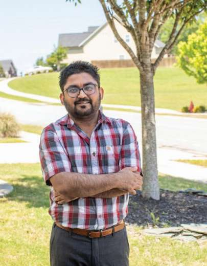 """""""PracticeLink also gives details about the job and employer, which helped me screen if I should proceed with contacting the employer or let it go,"""" says Inderpal Singh, M.D. - Photo by Kris Janovitz"""